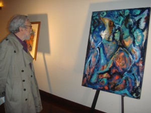 "Gerd taking in Suzanne's paintings at  ""Untamed,"" her solo exhibition at the Bogardus Mansion last year."