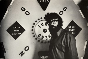 "Gerd in front of Contact Is ""The Only Love,"" the seven foot in diameter kinetic high way poem first shown at the San Francisco Museum of Art in 1963"